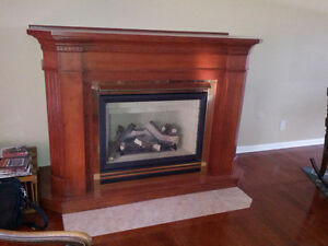 Heat-N-Glo Gas Fireplace and solid wood mantle