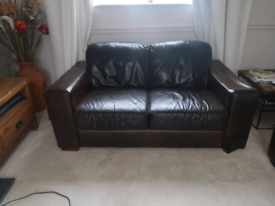 2 seater brown leather settee. Free to collector