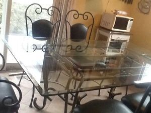 Glass top  kitchen table & 6 leather chairs