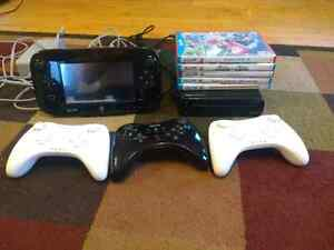 Wii U with 4 controllers and 8 games