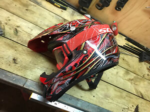 Red motocross helmet and goggles