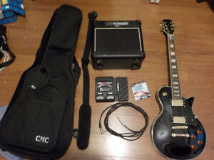 Electric Guitar, horrible amp, new strings, foot pedal