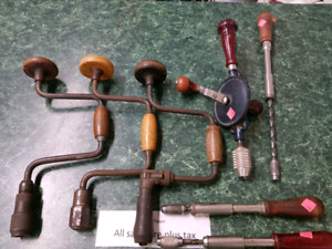 Vintage hand drills and screw drivers.