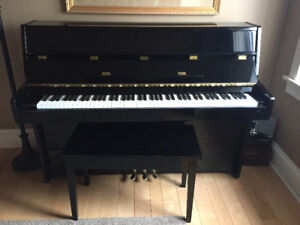 """Kawai 42"""" inch apartment size piano with player addition."""