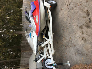 Two working jet skis with double trailer