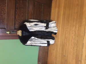 2 beautiful mink coats. One custom one made by Mannis Furs