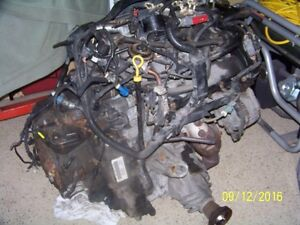 Ford escape 3lt complete transmisson and transfer case