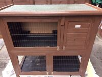 Double rabbit hutch 4ft long 4 ft high 2 ft wide.
