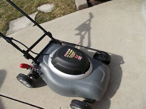 NEW COMPACT ELETRIC LAWNMOWER $125.00