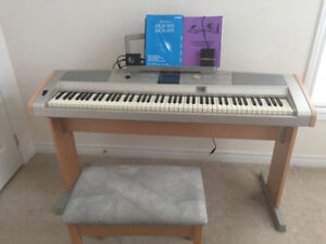 YAMAHA DGX - 505 grand piano/keyboard on a stand