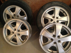 4/  CHEVROLET ALUMINUM RIMS & 2 ALL SEASON TIRES