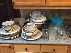 Assorted dishes /pots and pans/utensils/toaster