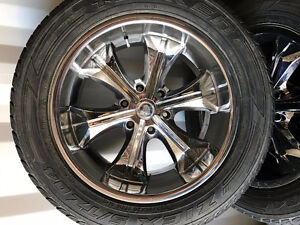 Selling four 20'' inch10'' wide Cadillac rims