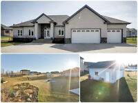 Stunning Acreage! City water on 1.13 acres with workshop + more!