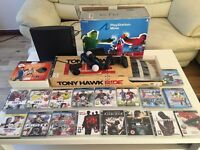 PlayStation 3 320GB + move eye + 18 games + 2 move and one normal controller