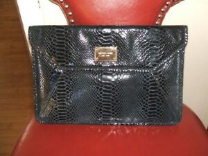 Michael kors . Clutch PURSE or Sleeve.Authentic.