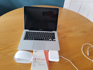 MacBook pro with Apple mouse and office