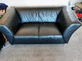 2x black leather sofas