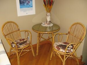 Rattan table with glass top & two chairs