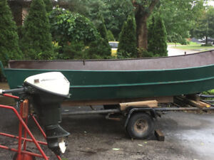 15 feet boat trailer and motor.