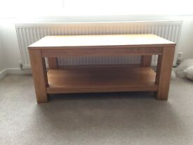 Solid oak coffee table. Design includes lower shelf too.