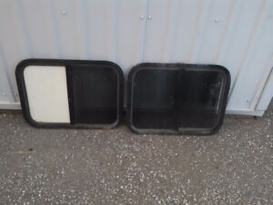 2 windows out of a horse trailer