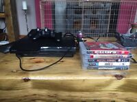 PS3 Slim with 2 controllers and games!....ONO