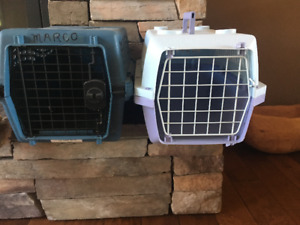 Two small dog kennels