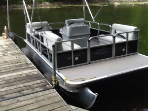 16 foot pontoon boat,with trailer and 50 hp motor.