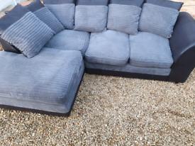 Black and grey cord corner sofa