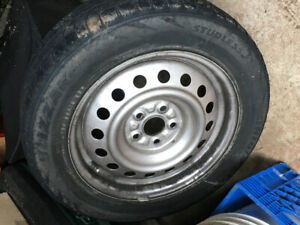 Four tires on rims 185R65/15
