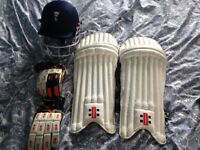 Cricket batting pads, helmet and gloves
