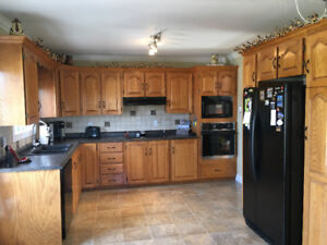Oak kitchen cabinets/countertop w/stove top and built in oven)