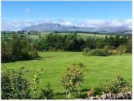 Holiday lodge with an unrestricted view of the North Lake District
