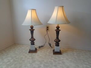 two in good shape nice heavy living/bedroom lamps $ 40 firm