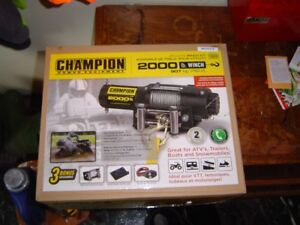 NIB Champion 2000 lb. ATV/UTV winch & accesories