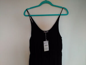 Long Zara dress with tags attached.
