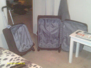 2 ROLLING LUGGAGE SET STACKS IN ONE ROLLING WHEELS AND EXT HNDLS