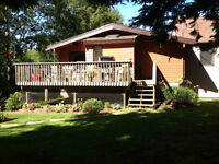 Beautiful log home in private setting 4 minutes from Wolfville