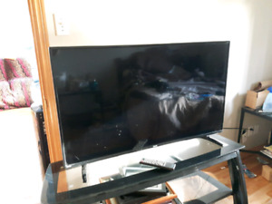"""46"""" flat screen RCA/solid glass stand"""