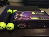 Zumba DVDs and 2 sets of toning sticks never used!