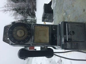 Old antique dial pay phone