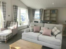 Luxury brand new static lodge for sale with full wrap decking on Norfolk Coast