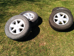 255/65R16 tires and rims from a 2001 Nissan Pathfinder LE