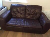 Dark brown two seater sofa