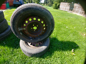 Selling 2 motormaster 205 55 16 tires with rims