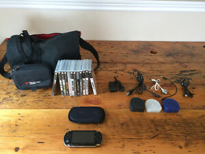 Playstation Portable (PSP) with carrying case, games, and movies