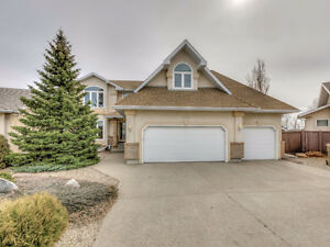 Spacious and immaculate two storey with park-like yard!