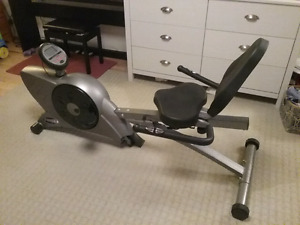 Reclined stationary bicycle