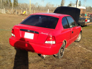 2003 Hyundai Accent Red Coupe (2 door)